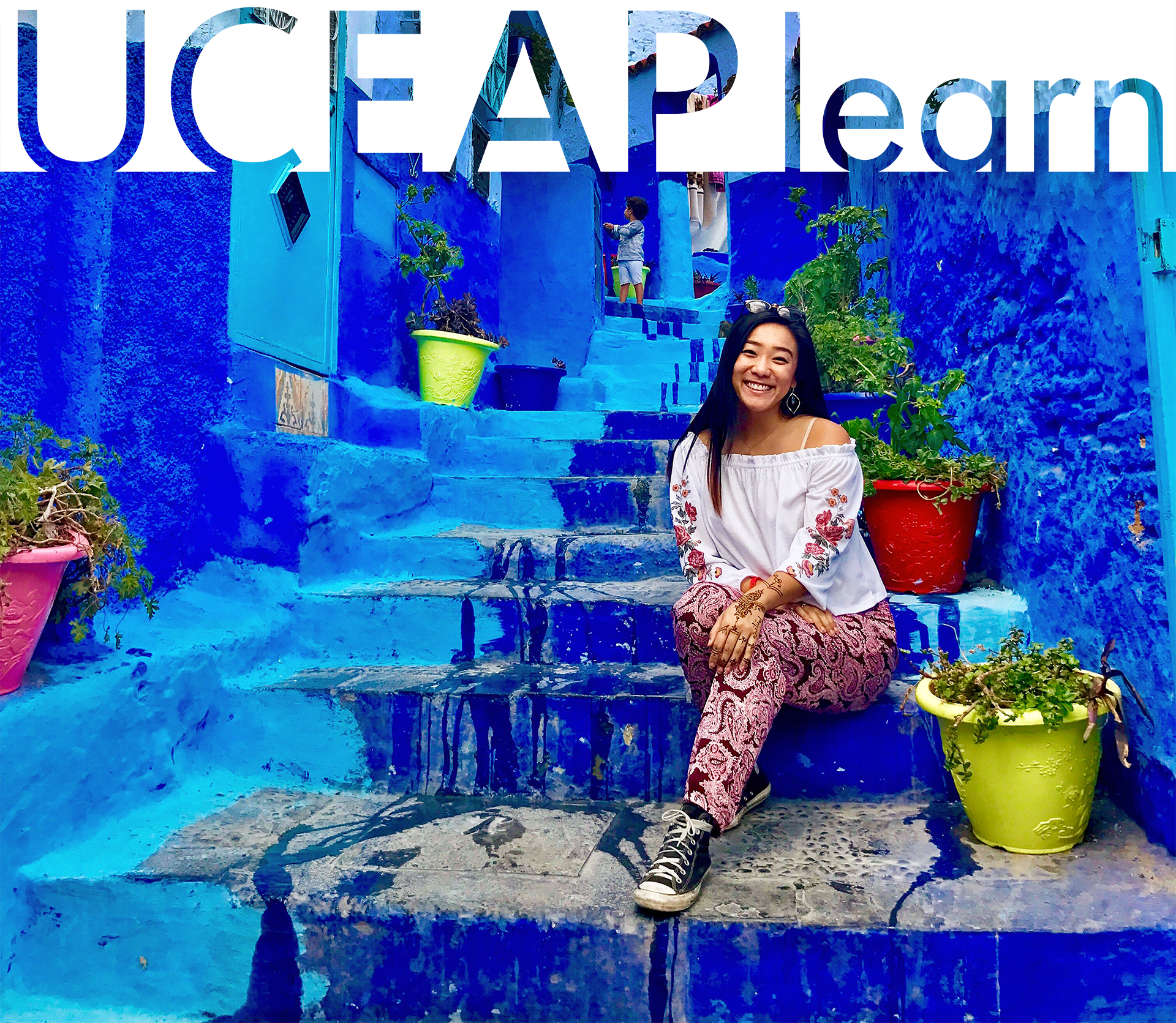 UCEAP student sits on colorful steps in Morocco